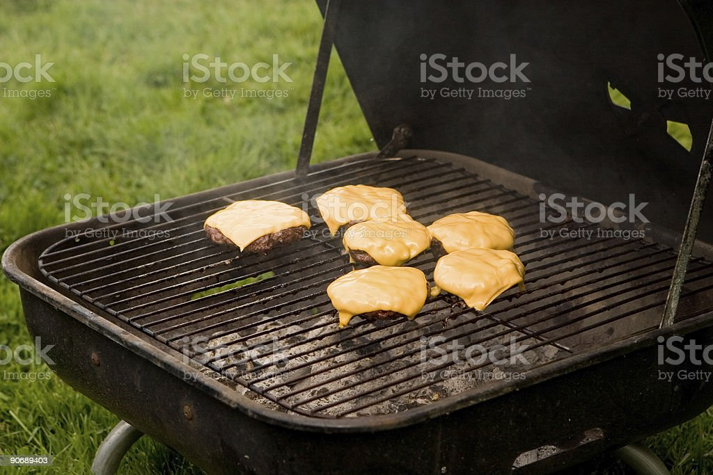 Cheeseburgers on grill stock photo