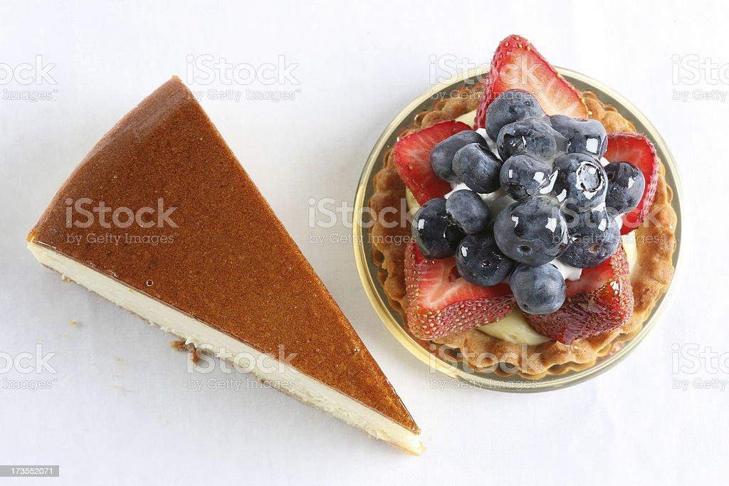 Cheesecake and fruit tart royalty-free stock photo