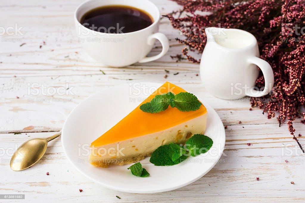 Cheesecake,  coffee, milk jar and heather flowers stock photo