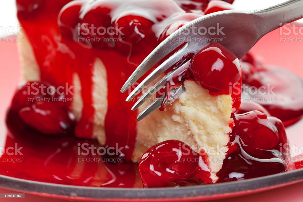 A cheesecake covered in a cherry sauce stock photo
