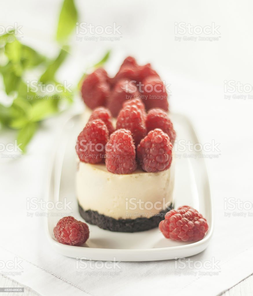 Cheesecake decorated with raspberries royalty-free stock photo