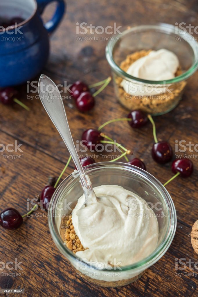 Cheesecake mixture in a jar. Cheese and graham crackers crumb. stock photo