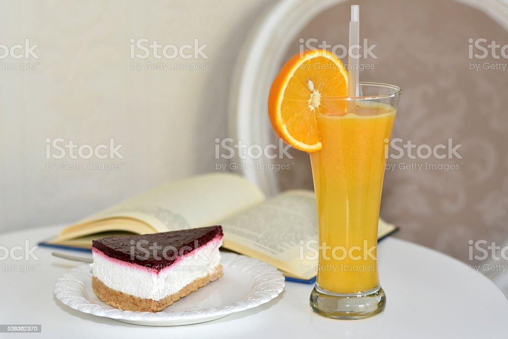 Cheesecake & orange juice stock photo