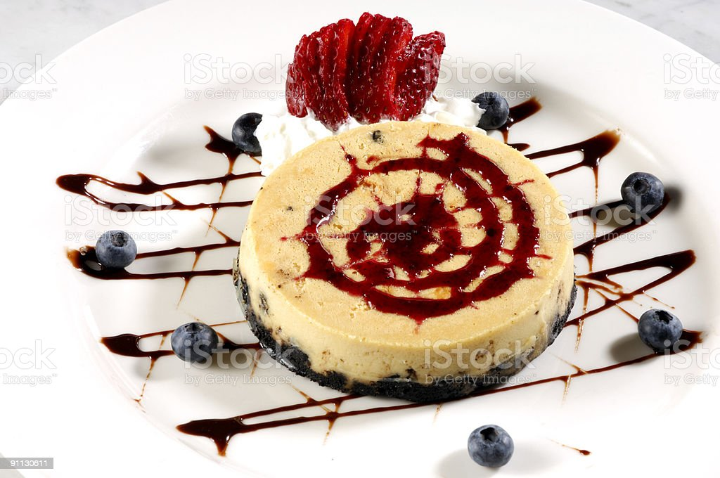 Cheesecake Raspberry Sauce and Fresh Fruit royalty-free stock photo