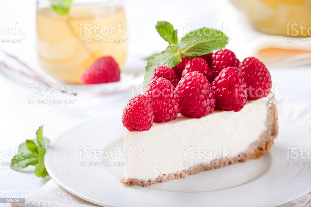 Cheesecake slice with fresh raspberry stock photo