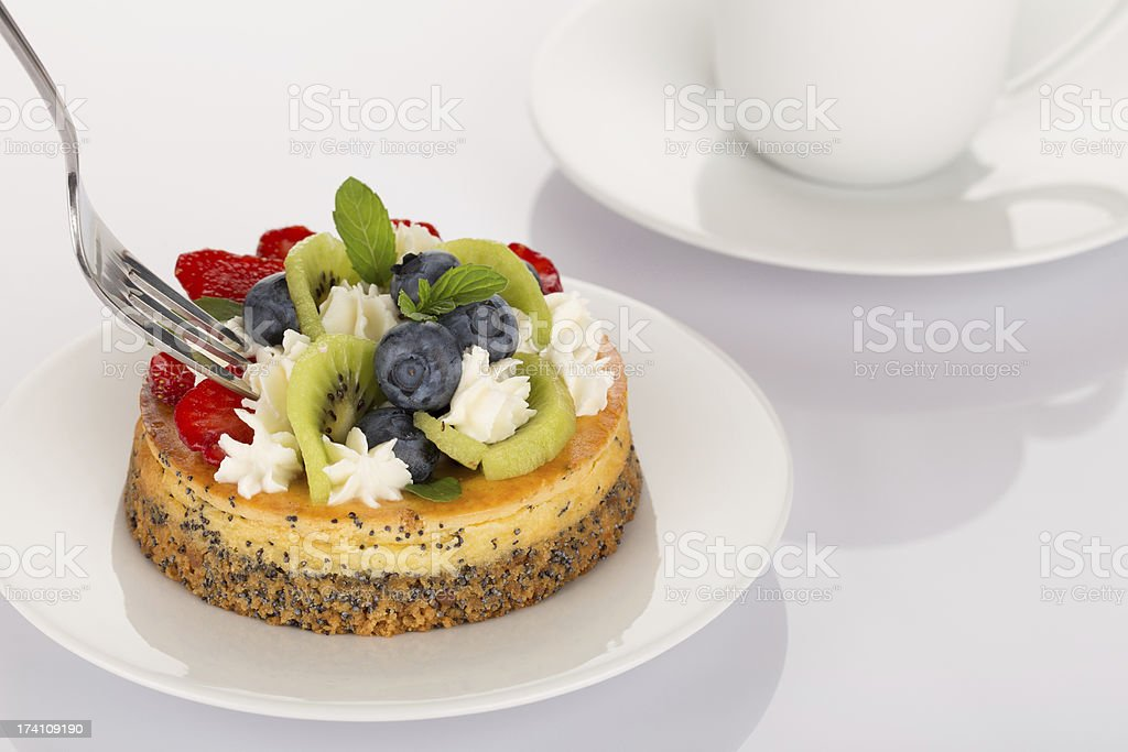 Cheese-cake, strawberries, blueberries and kiwi royalty-free stock photo