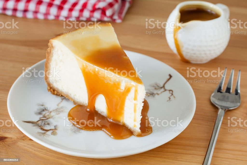 Cheesecake with caramel sauce on white plate stock photo