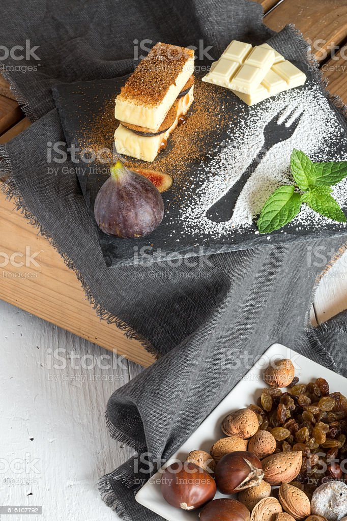 Cheesecake with figs and strawberry jam stock photo