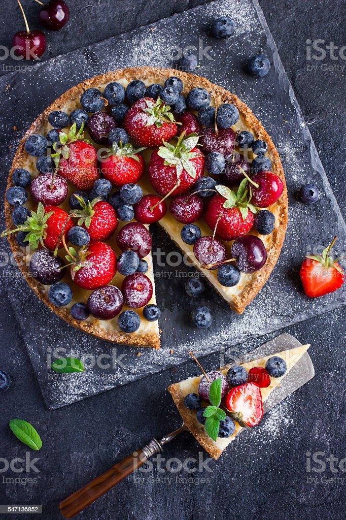 cheesecake with fresh summer berries stock photo