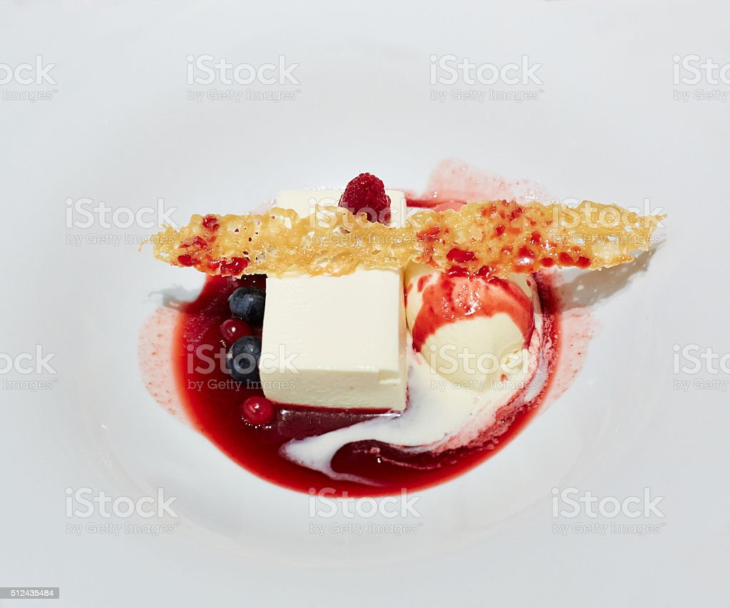 Cheesecake with ice cream and cranberry topping sauce stock photo