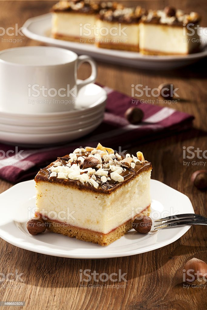 cheesecake with nuts on plate stock photo