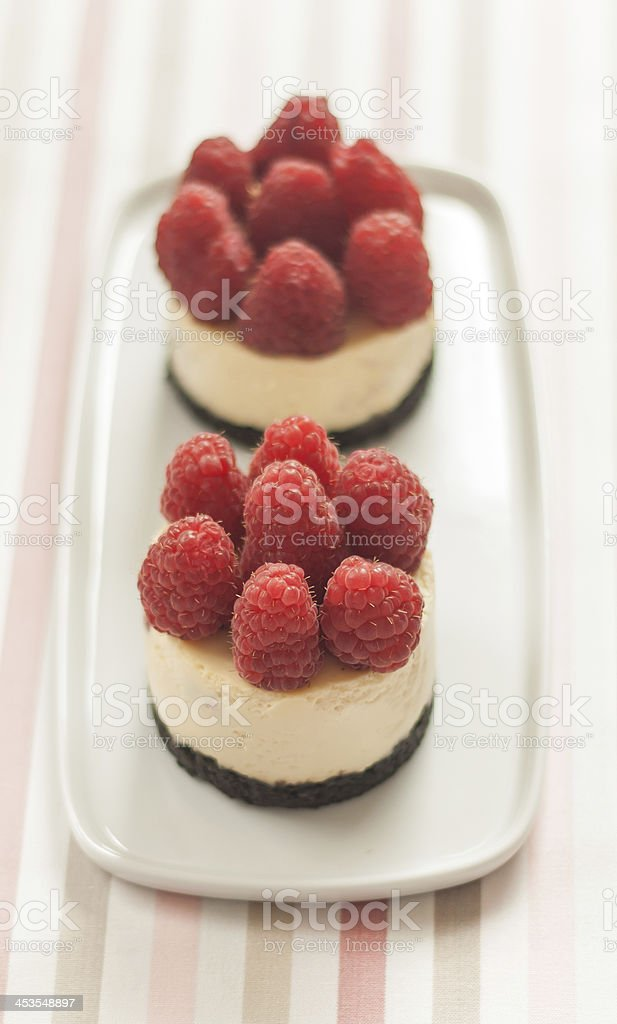 Cheesecake with raspberries royalty-free stock photo