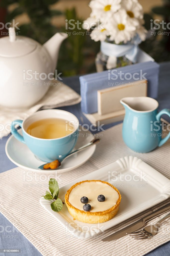 cheesecake with tea in the restaurant stock photo
