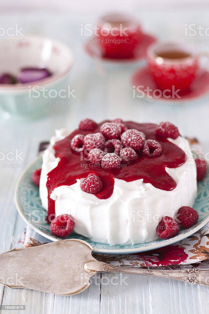 Cheesecake with whipped cream and raspberry royalty-free stock photo