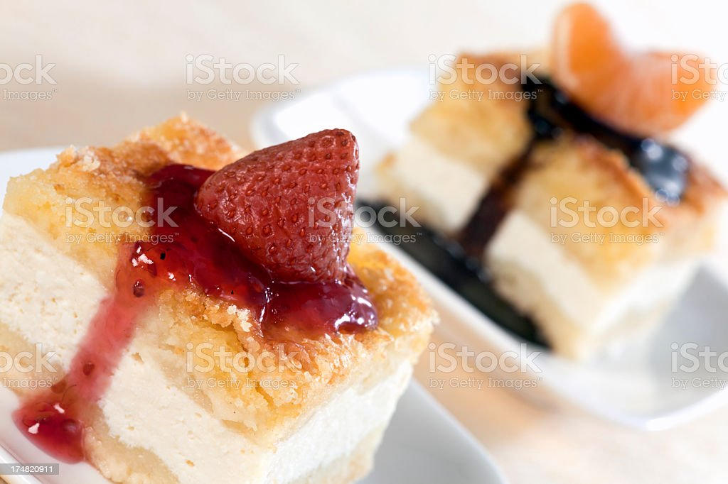 Cheesecakes with strawberry and tangerine royalty-free stock photo