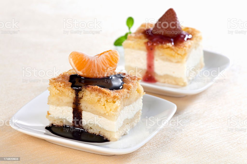 Cheesecakes with tangerine and strawberry royalty-free stock photo