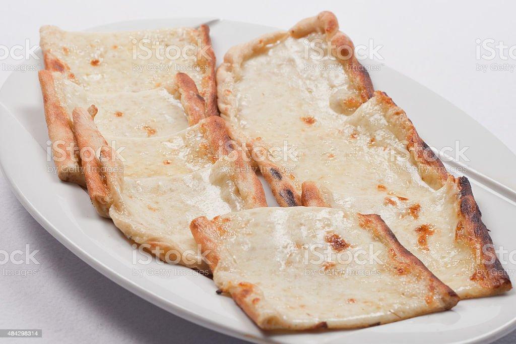 Cheesed Turkish pizzas stock photo