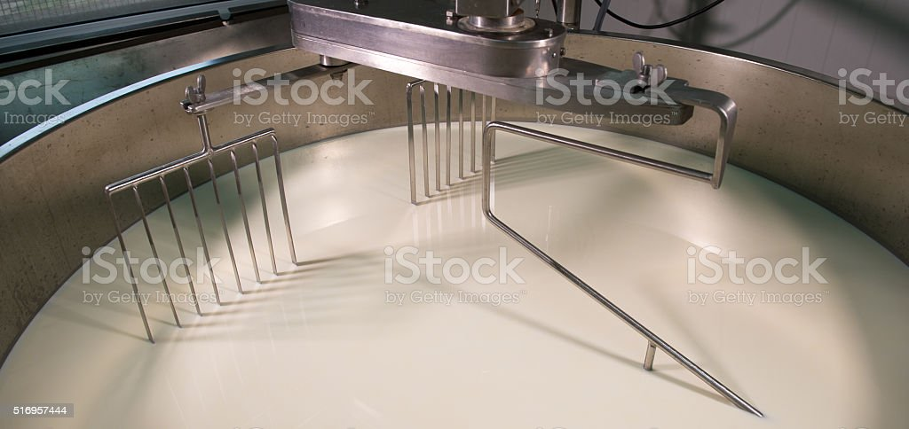 Cheesemaker -Traditional cheese making at a creamery, stock photo