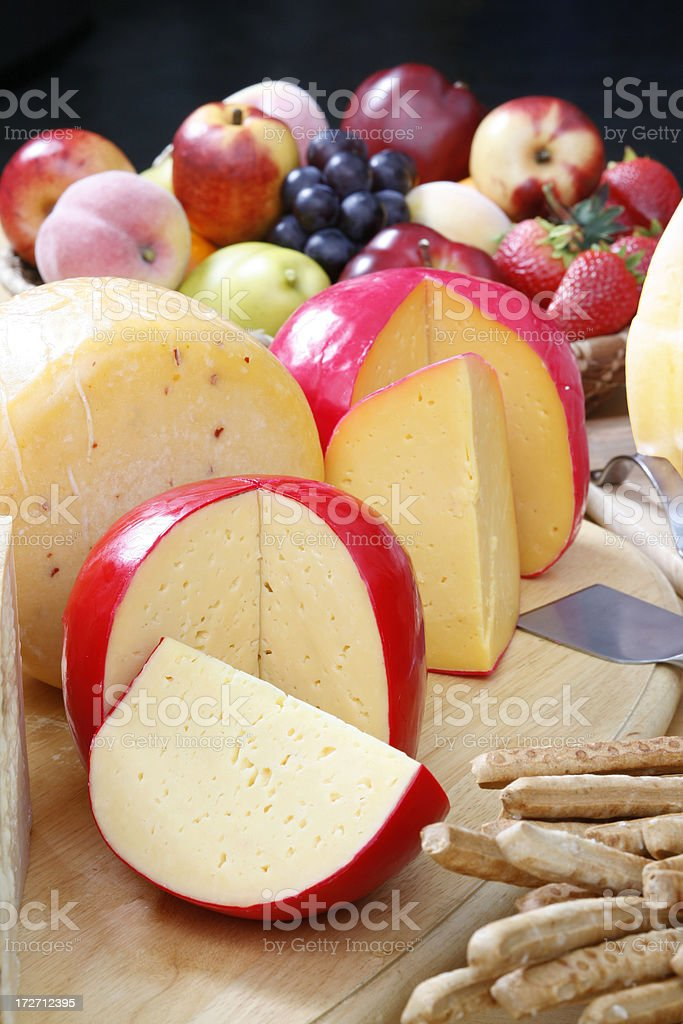 Cheeses and fruits stock photo