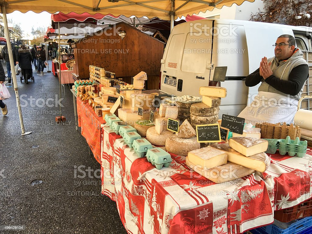 Cheeses for sale on a market stall - France stock photo