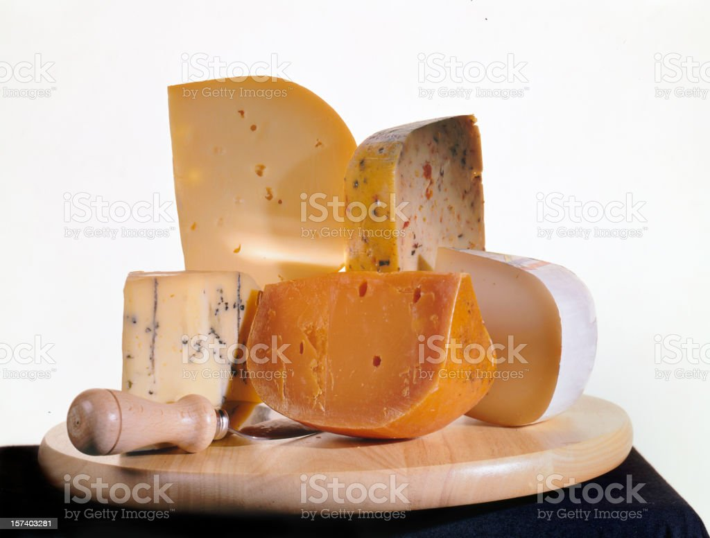 cheeses on a wooden plate royalty-free stock photo