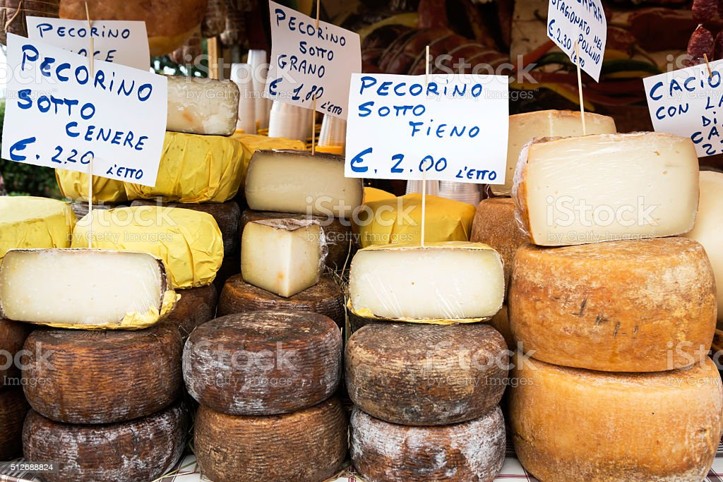 Cheeses on market stall stock photo