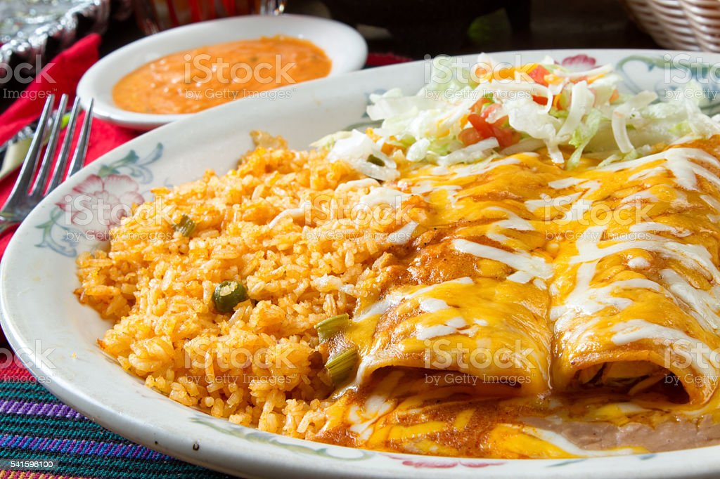 Cheesy Enchiladas in a Mexican Restaurant stock photo