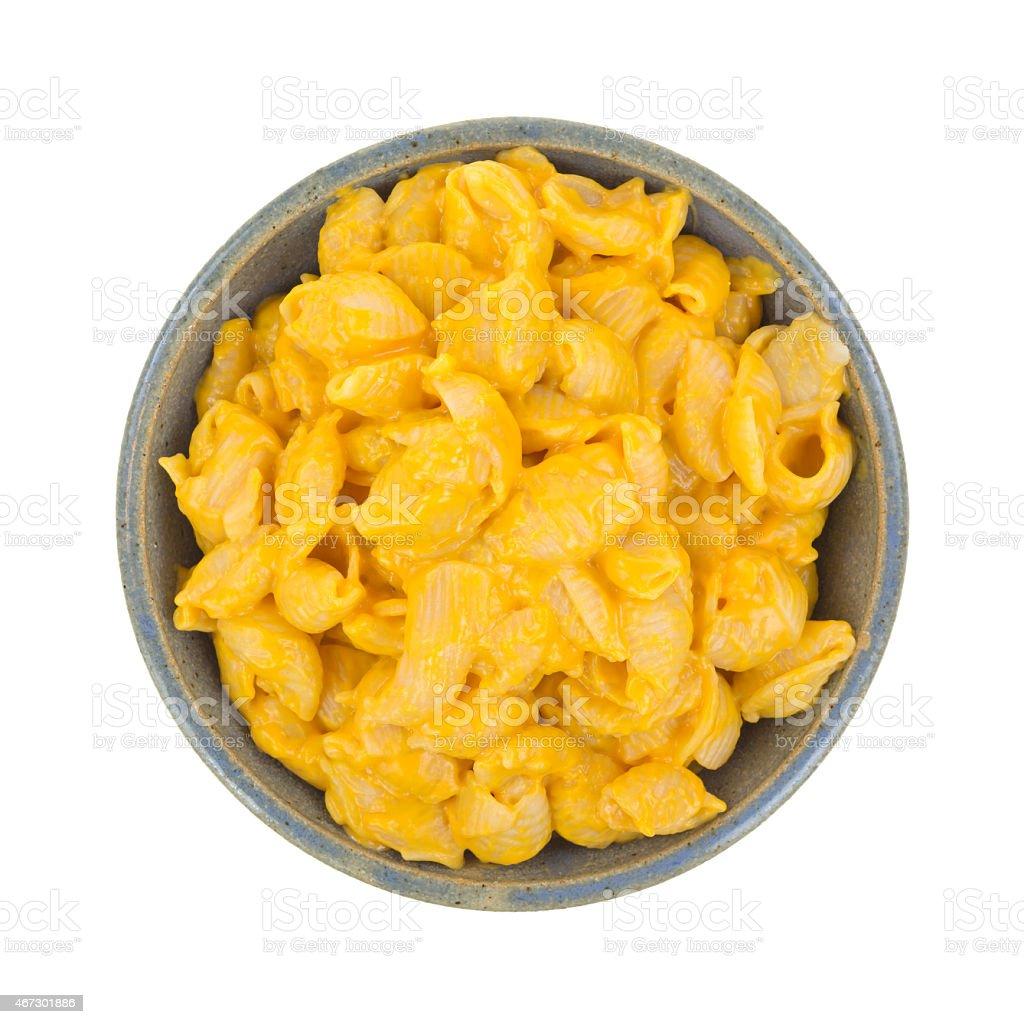 Cheesy pasta shells in bowl stock photo