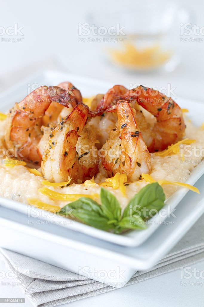 Cheesy Shrimp and grits_cheddar garnish stock photo
