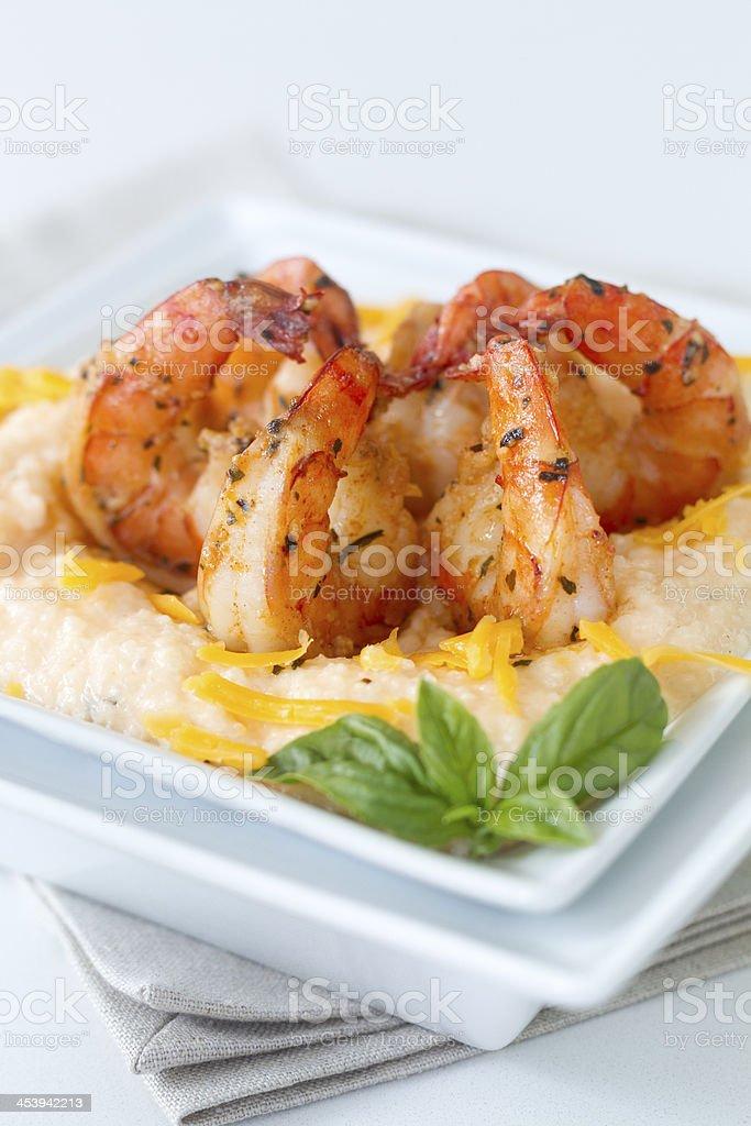 Cheesy Shrimp and grits_plain background stock photo