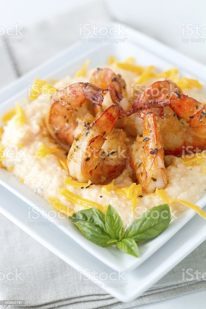 Cheesy Shrimp and grits_vertical stock photo