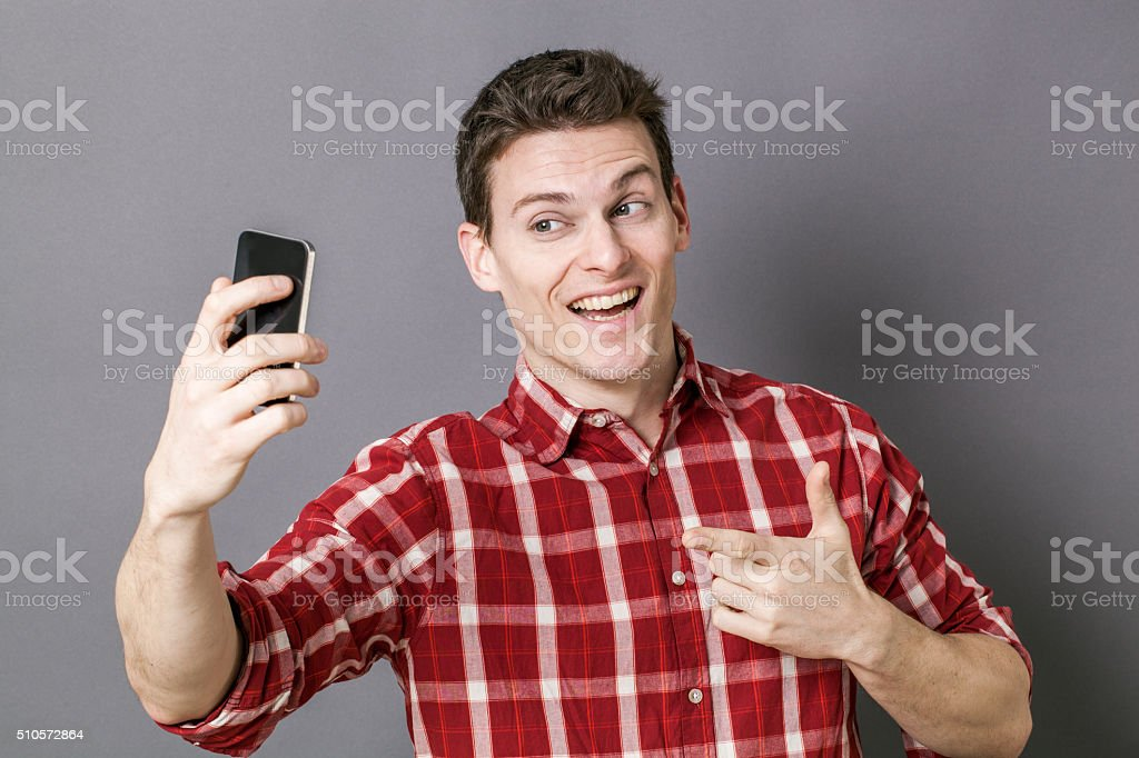 cheesy young sportsman taking selfie for seduction stock photo