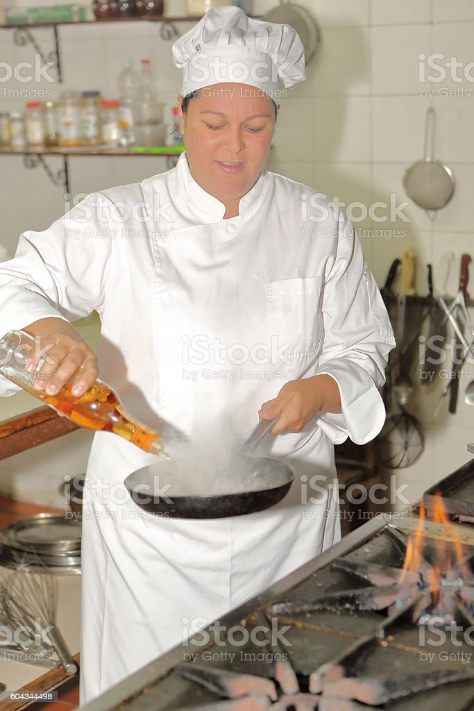 Chef adds Liquid to Star Flaming stock photo