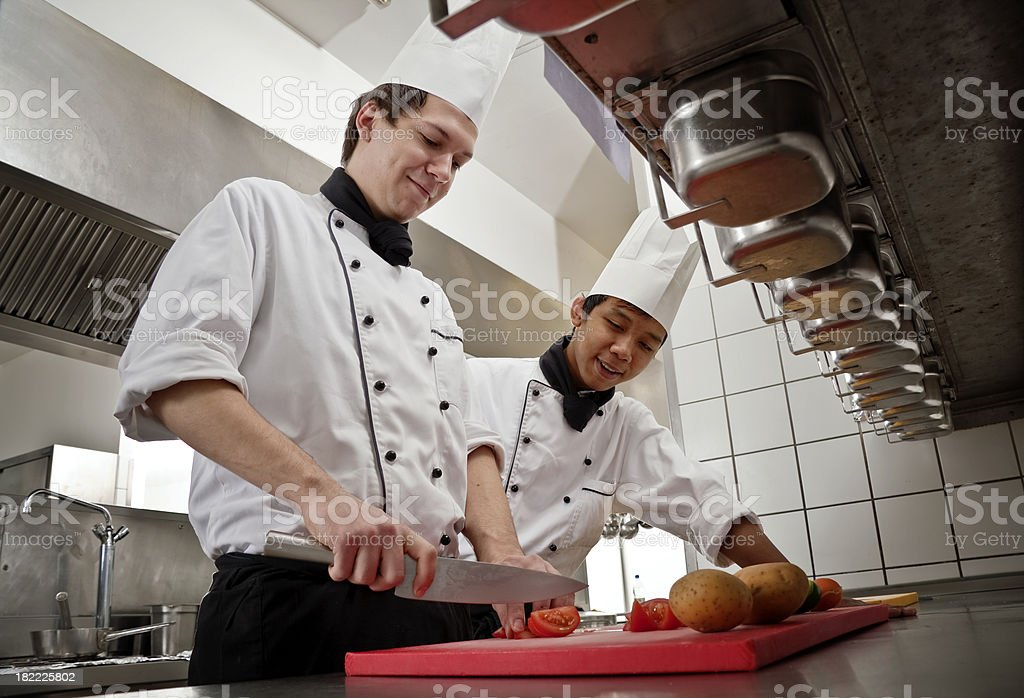 Chef and Trainee stock photo