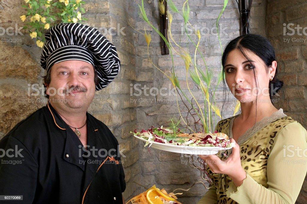 Chef and waitress royalty-free stock photo