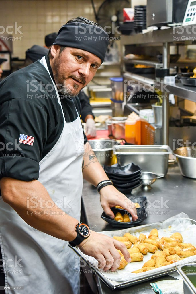 Chef at his Kitchen stock photo