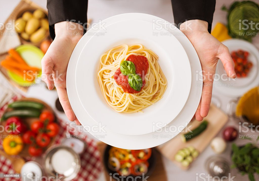 Chef at work cooking pasta stock photo