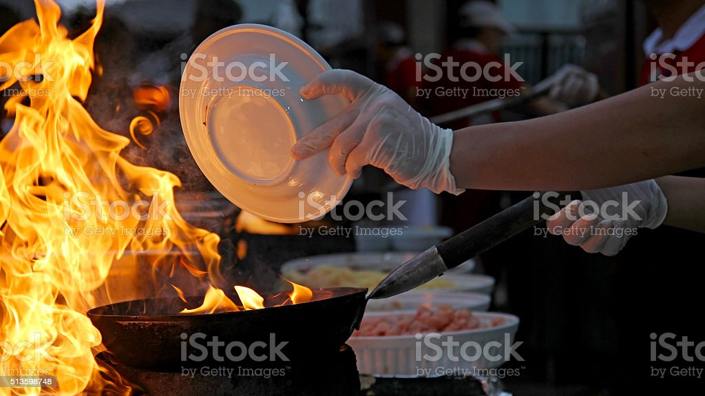 Chef at work - Flambe cooking stock photo