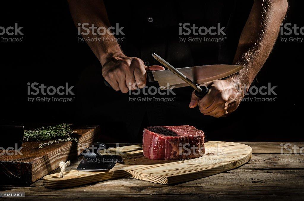 Chef butcher prepare beef steak stock photo