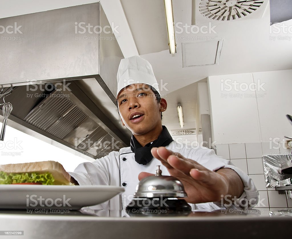 chef calling a waitress for her order stock photo