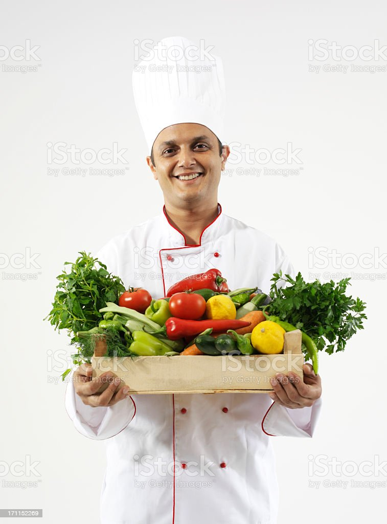 chef carrying vegetables stock photo
