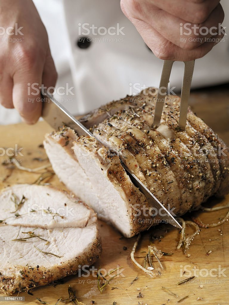 Chef Carving a Pork Roast stock photo