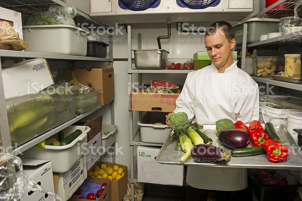 Chef checking his stockroom in preparation for the menu stock photo