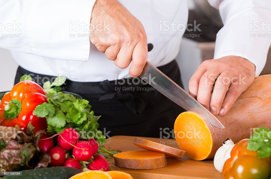 Chef chopping vegetables stock photo