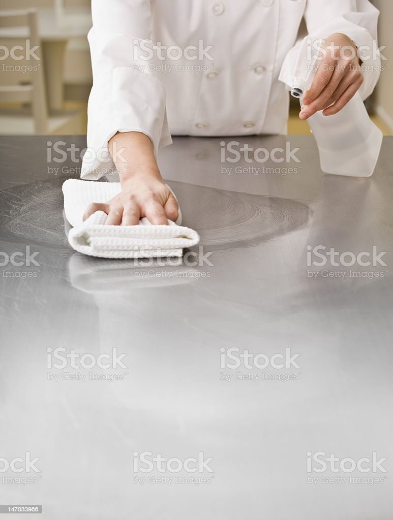 Chef Cleaning Counter royalty-free stock photo