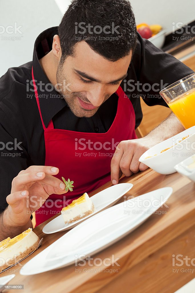 Chef Completing Cake royalty-free stock photo