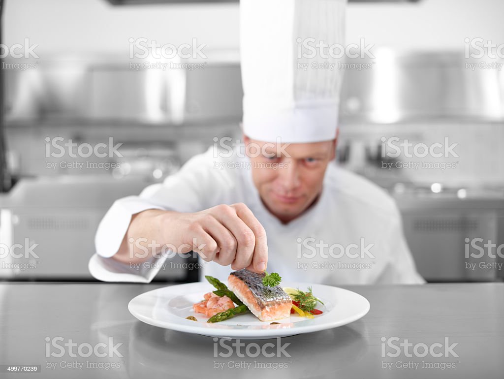 Chef Completing Fish stock photo