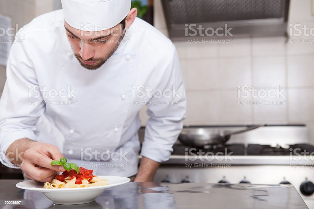 Chef Completing Pasta stock photo