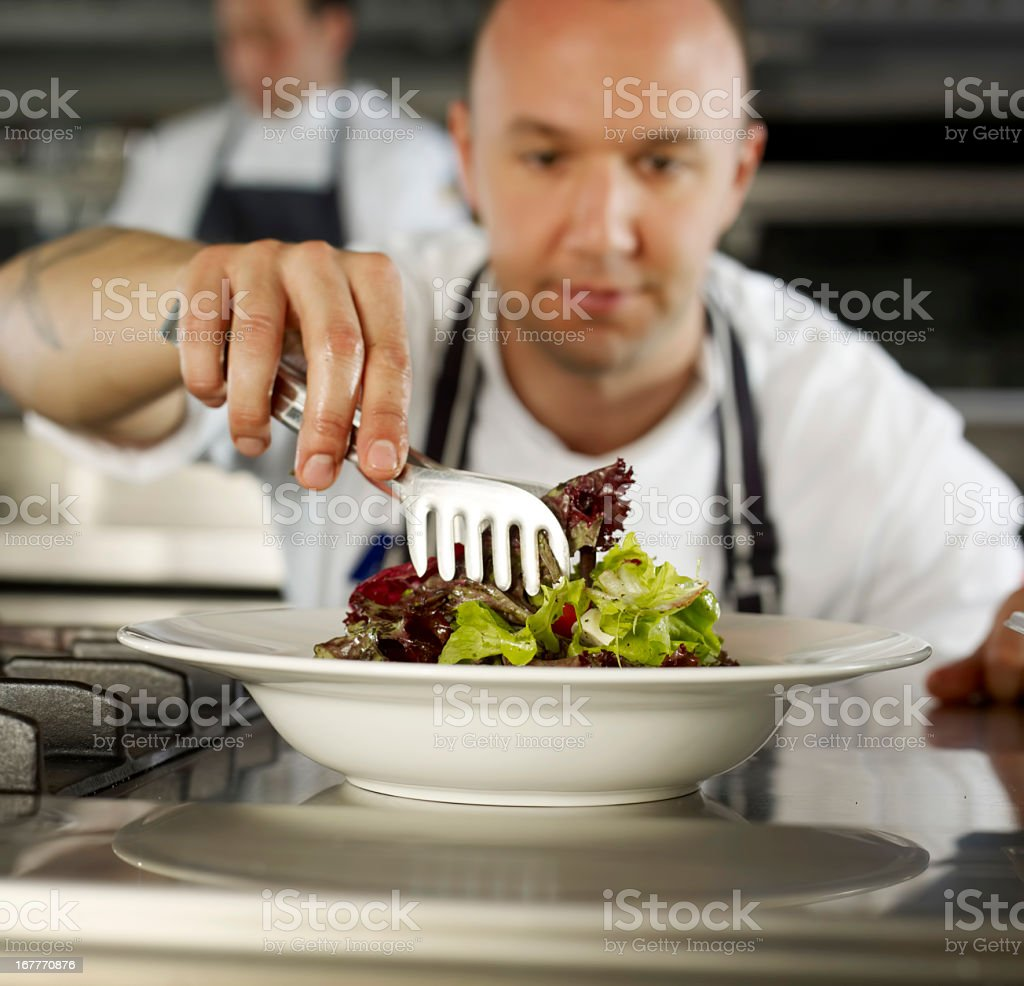 Chef completing Salad royalty-free stock photo
