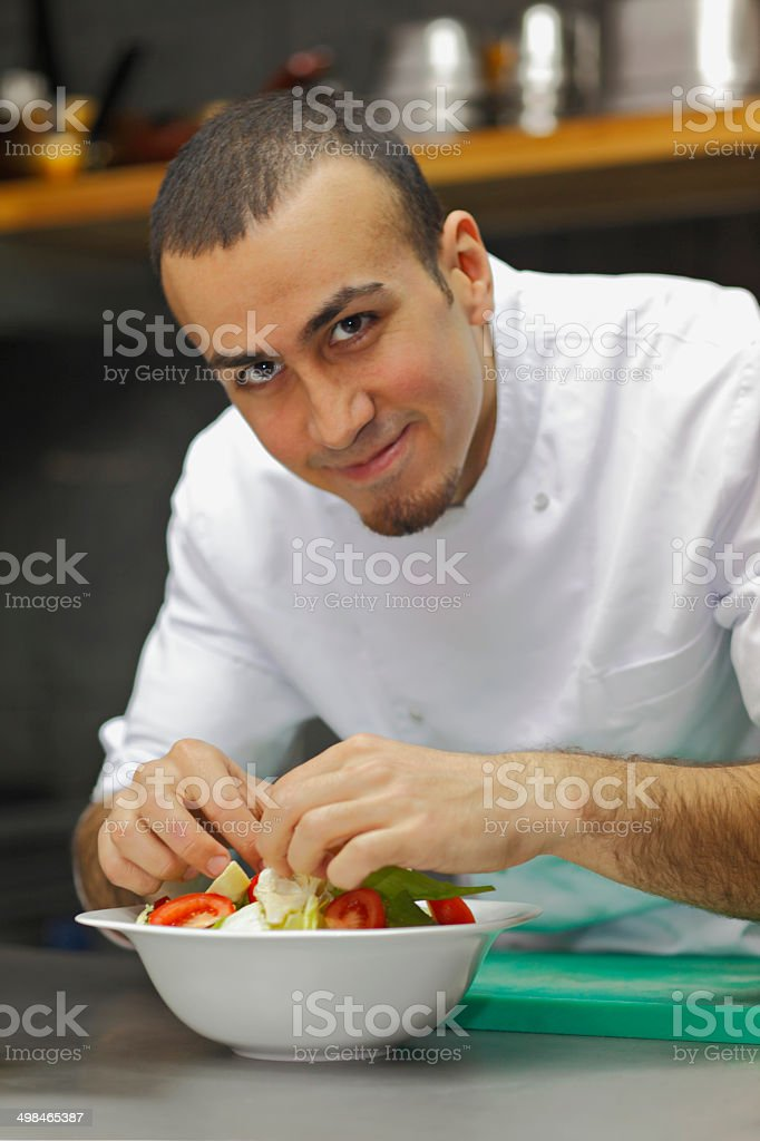 Chef completing  salad. stock photo